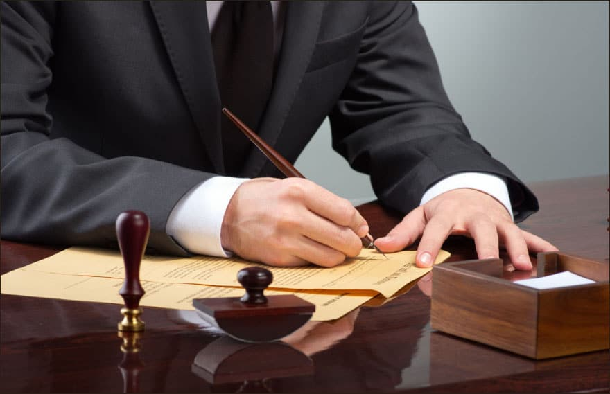 lawyer signs contract